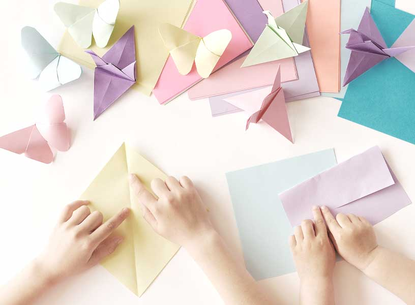 Children playing with origami